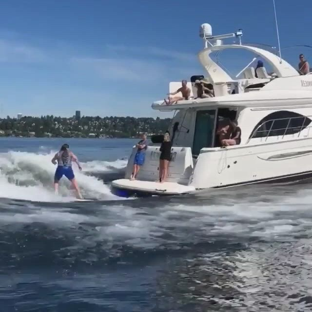 Surf the wake - Video & GIFs   surfing behind a boat,surfing,wakeboarding,surf house,surfer magazine,surf art,surf girls,beach waves,fishing boats,water sports,surf style