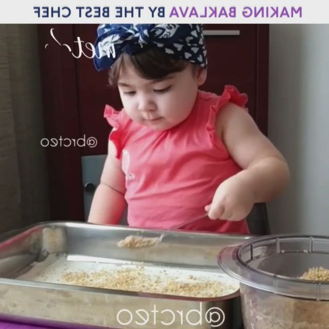 Little girl making baklava